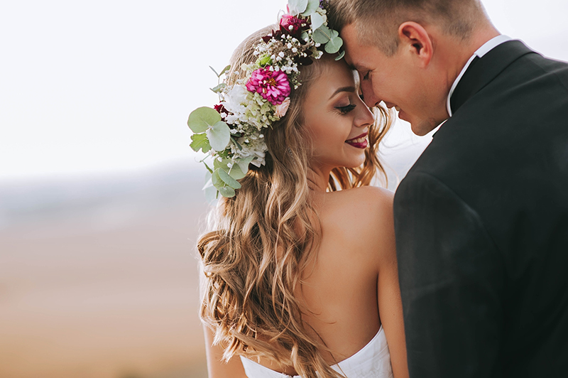 bride-with-flowers-and-groom
